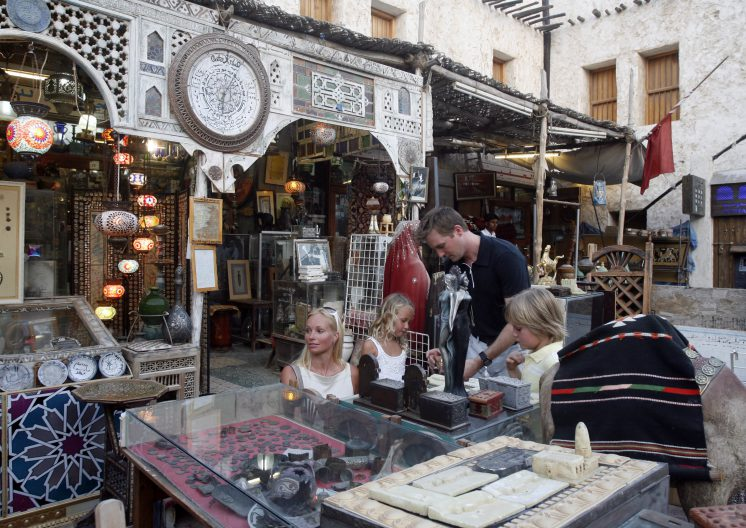 Foreigners buying crafts at Souq Wakif Doha Qatar